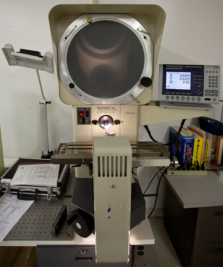 Optical Comparator used to inspect the tool marks on a mirror mount backplate.