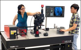 Two Scientists Using a Bergamo II Microscope