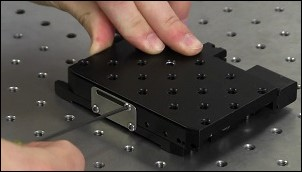 The locking plate can be used to hold a linear translation stage in the desired position.